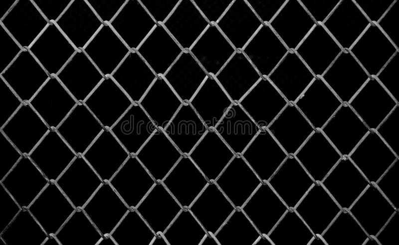Mesh fence background.Grid iron grates, Grid pattern, steel wire mesh fence wall background, Chain Link Fence with White. stock photography