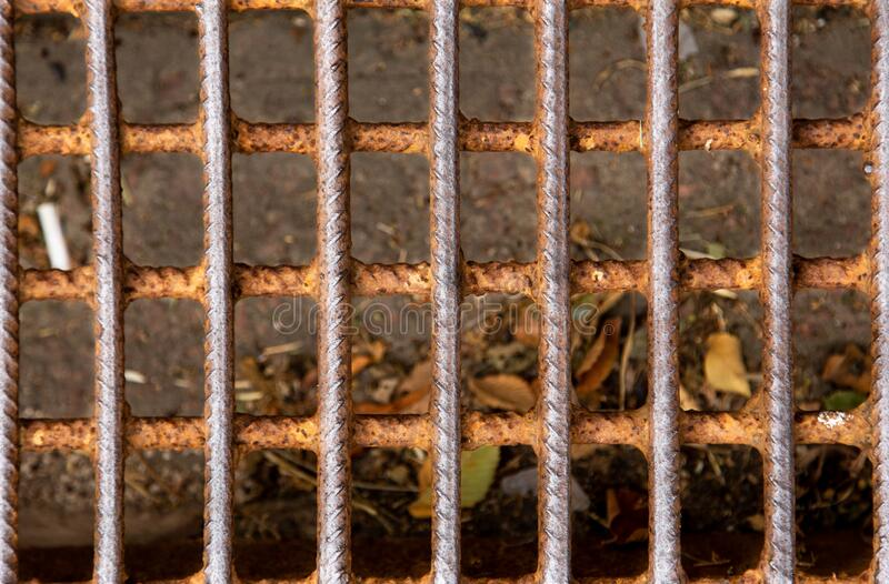 Mesh fence background.Grid iron grates, Grid pattern, steel wire mesh fence wall background, Chain Link Fence with brown. Background. close up background royalty free stock photography