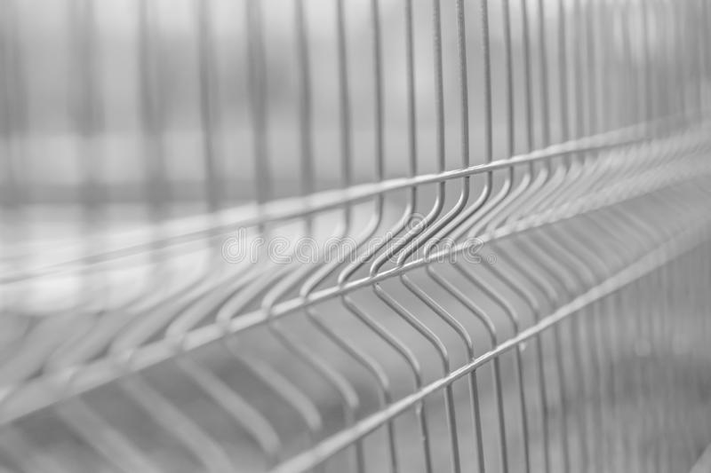 Mesh fence. Selective focus. Black and white photo.  royalty free stock photography