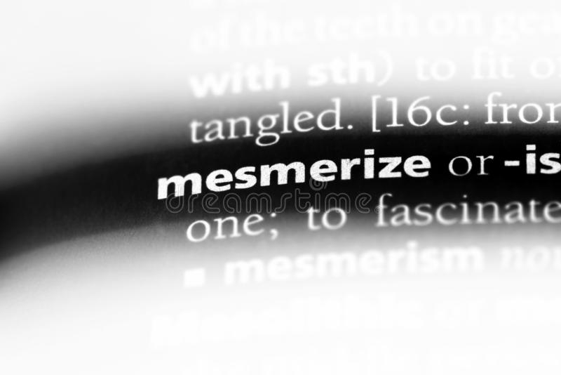Mesmerize. Word in a dictionary.  concept royalty free stock photography