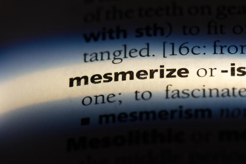 Mesmerize. Word in a dictionary.  concept stock photography