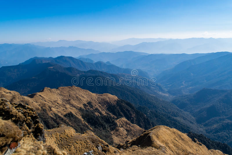 Mesmerizing landscape of moist decidous & coniferous forest of Himalayas mountains rom Deoria Tal trail in Uttrakhand. Kedarnath Wild Life Sanctuary a national royalty free stock photo