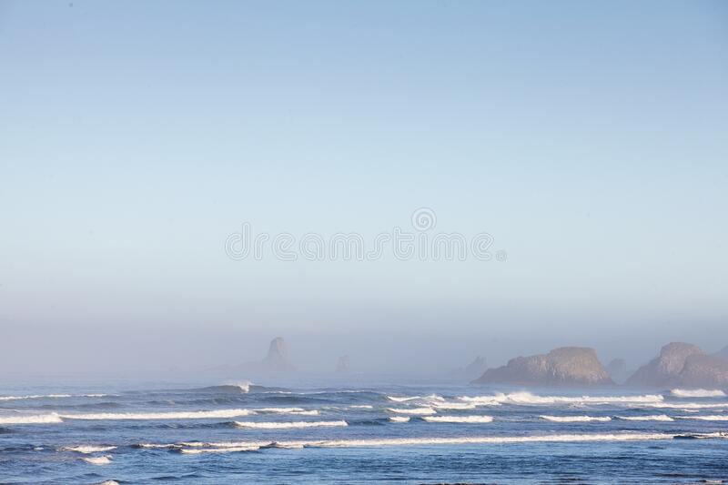 Mesmerizing scenery of ocean waves at Cannon Beach,  Oregon, USA. A mesmerizing scenery of ocean waves at Cannon Beach,  Oregon, USA royalty free stock photos