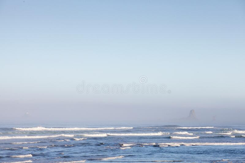 Mesmerizing scenery of ocean waves at Cannon Beach,  Oregon, USA. A mesmerizing scenery of ocean waves at Cannon Beach,  Oregon, USA stock image