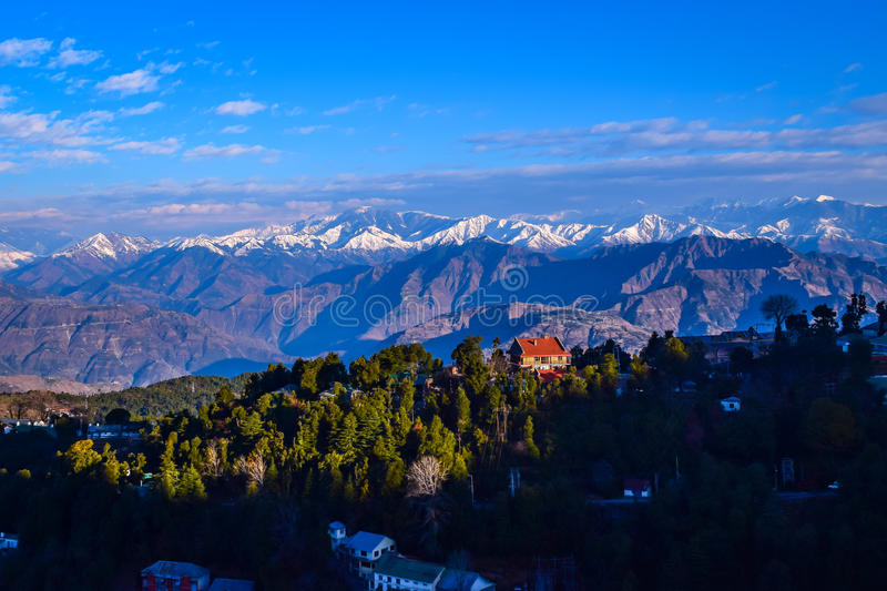Mesmerizing view on a winter morning at Dalhousie. Dalhousie is beautiful hill station in Himachal Pradesh. Town offers panoramic view snow cladded Pir Panjal royalty free stock photography