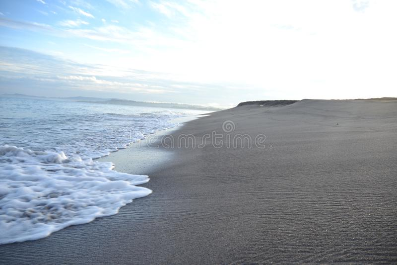 Mesmerizing Wave and Sand royalty free stock images