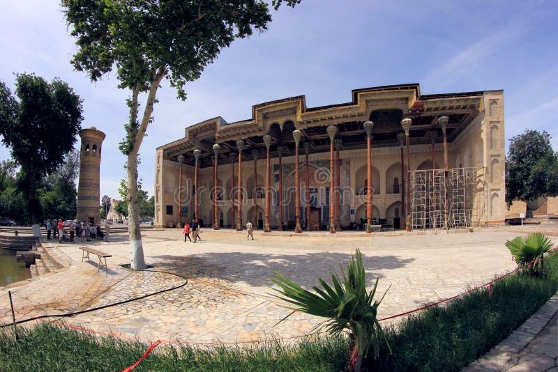 Mesquita e minarete do bolo-Hawz na cidade de Bukhara, Usbequistão fotos de stock