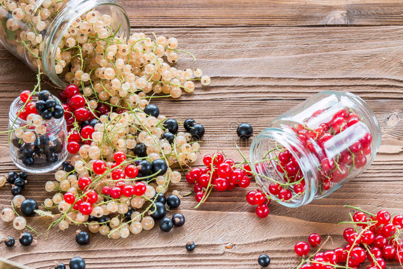 Mess of berries, vitamins and antioxidants on wooden table. Mess of berries, vitamins and antioxidants royalty free stock photos