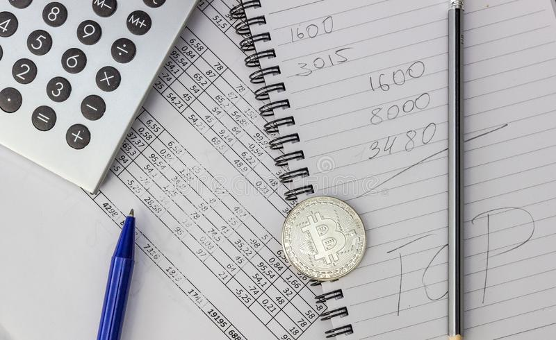 Mess on your desktop. Calculator, notebook, documents, Bitcoin royalty free stock photography