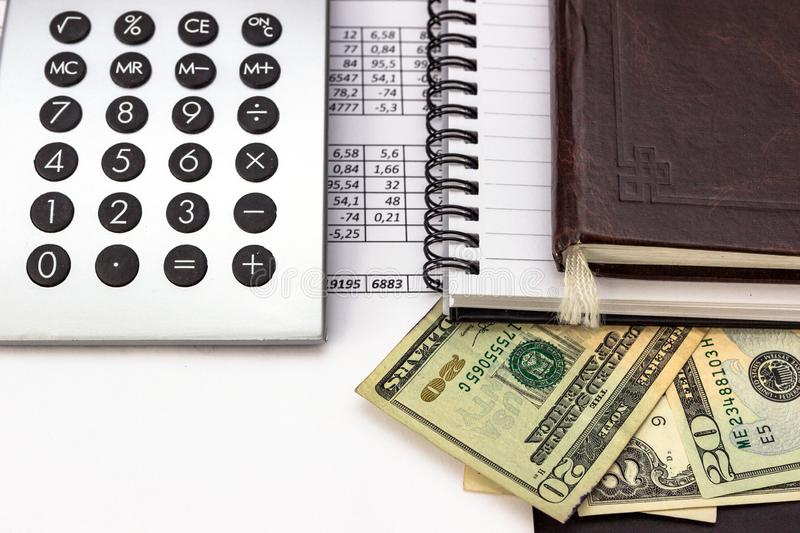 Mess on your desktop. Calculator, notebook, documents, Bitcoin, USD, paper money, office supplies stock image