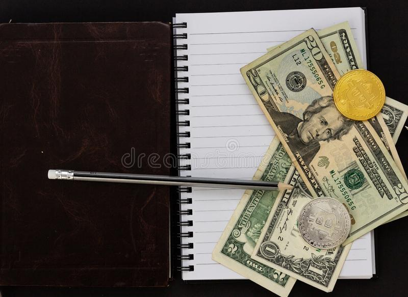 Mess on your desktop. Calculator, notebook, documents, Bitcoin, USD, paper money, office supplies royalty free stock photos