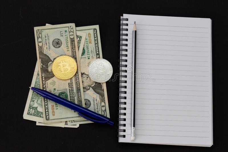 Mess on your desktop. Calculator, notebook, documents, Bitcoin, USD, paper money, office supplies royalty free stock images