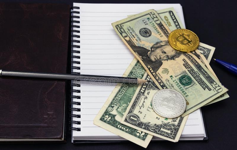 Mess on your desktop. Calculator, notebook, documents, Bitcoin, USD, paper money, office supplies royalty free stock photography