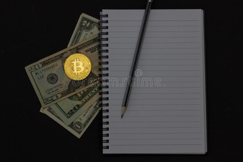 Mess on your desktop. Calculator, notebook, documents, Bitcoin, USD, paper money, office supplies stock images