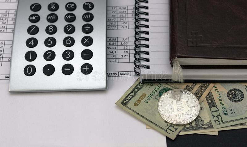 Mess on your desktop. Calculator, notebook, documents, Bitcoin royalty free stock images