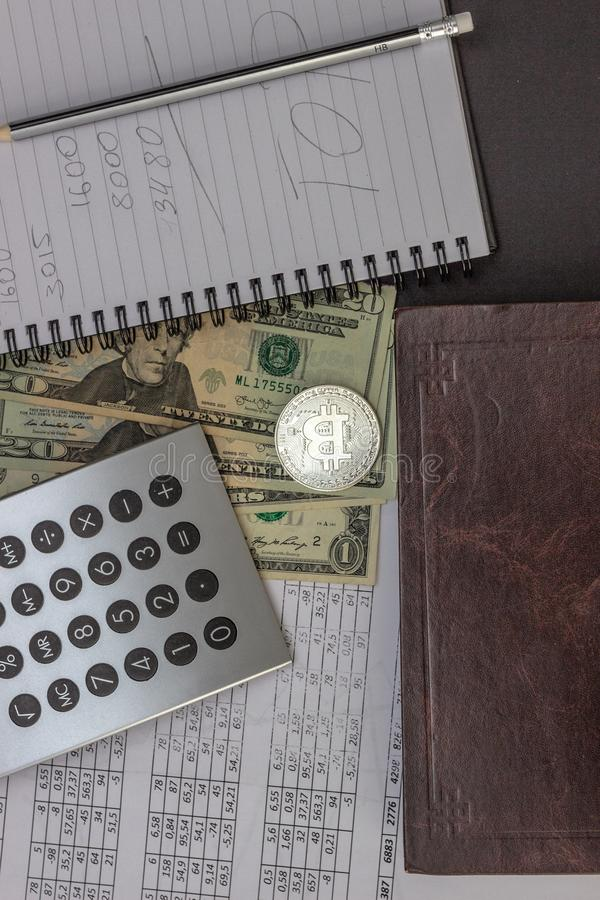 Mess on your desktop. Calculator, notebook, documents, Bitcoin, USD royalty free stock photos