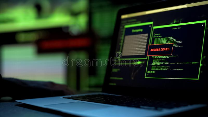 Message Access denied written on laptop screen, server blocking hacking attempt. Stock photo royalty free stock photo