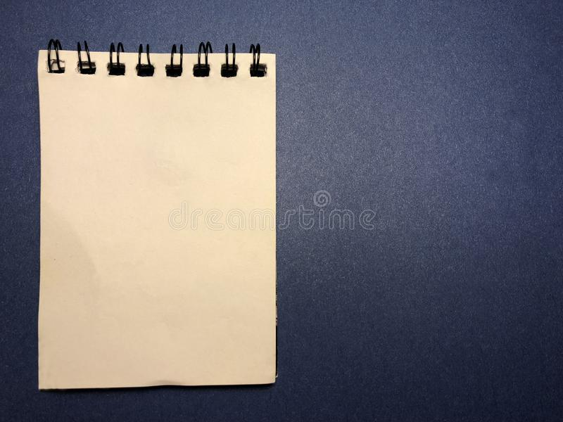 Message board with notebook on dark blue background. royalty free stock photos
