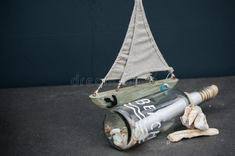 Message In A Bottle Glass Paper Summer Beach Vibe Shells Grey Ba stock photos