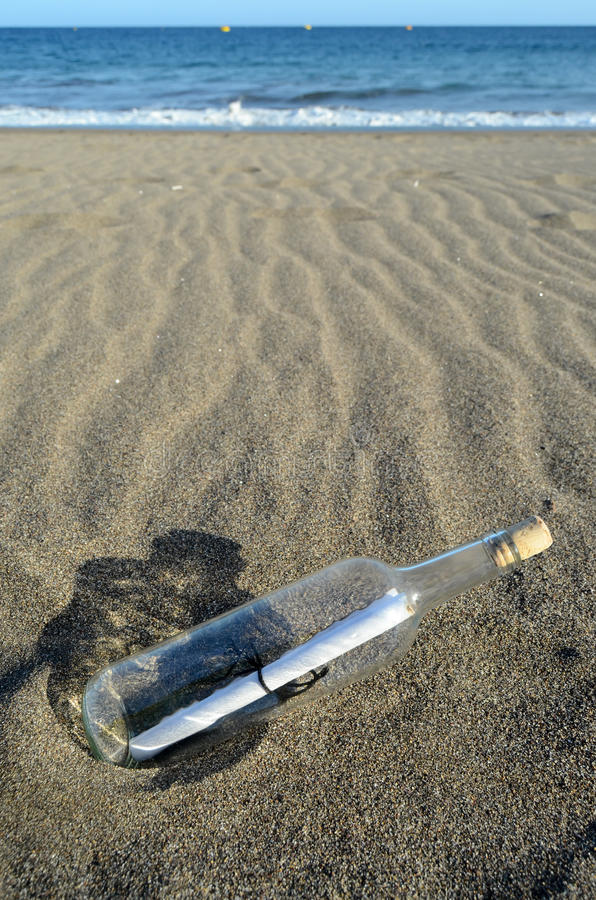 Message In A Bottle. On the sand Beach royalty free stock photos