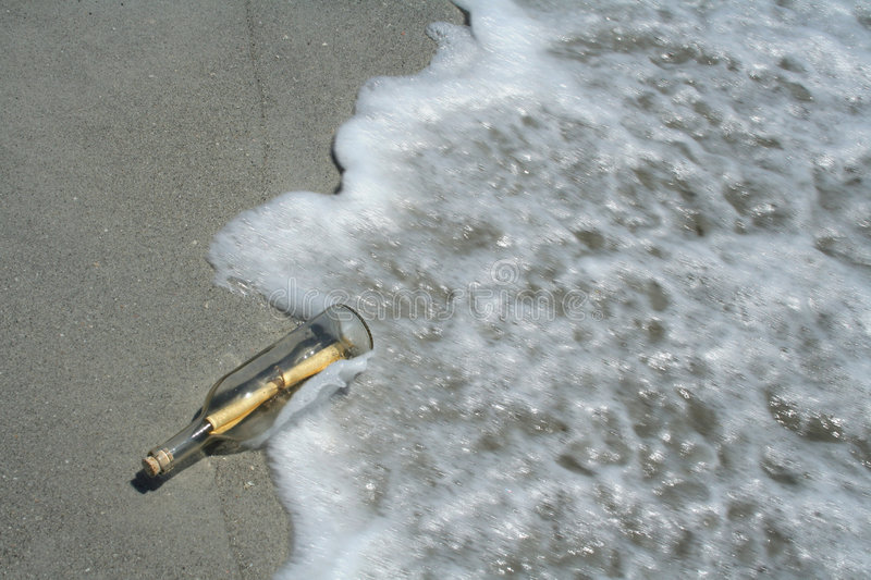 Message in bottle in surf royalty free stock photo