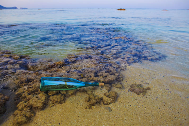 Message in a bottle washed ashore royalty free stock photo