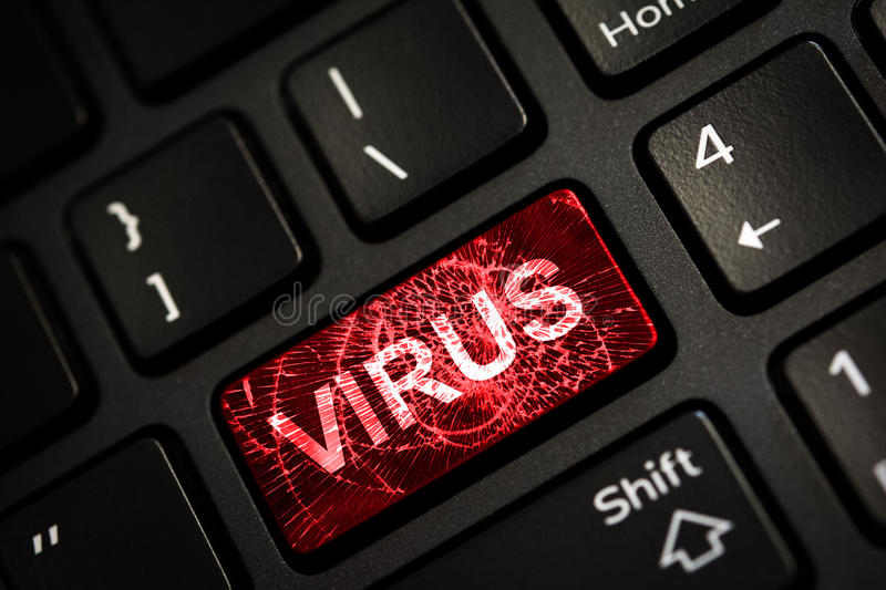 Message on broken red enter key of keyboard. Computer virus attack. Copy space stock photography