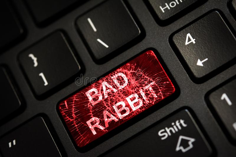 Message on broken red enter key of keyboard. Computer Bad Rabbit virus attack. Copy space stock photos