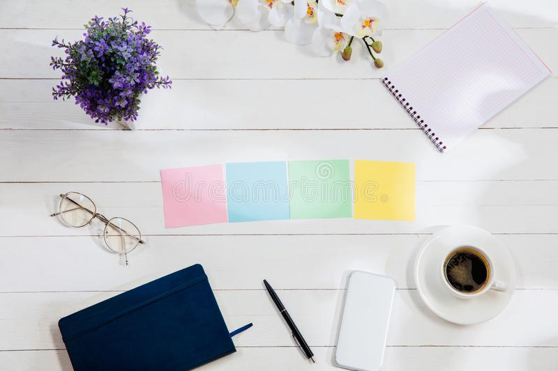 Message at colorful note papers on a desk background. stock photography