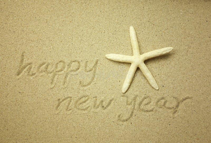 Message de bonne année sur le sable image stock