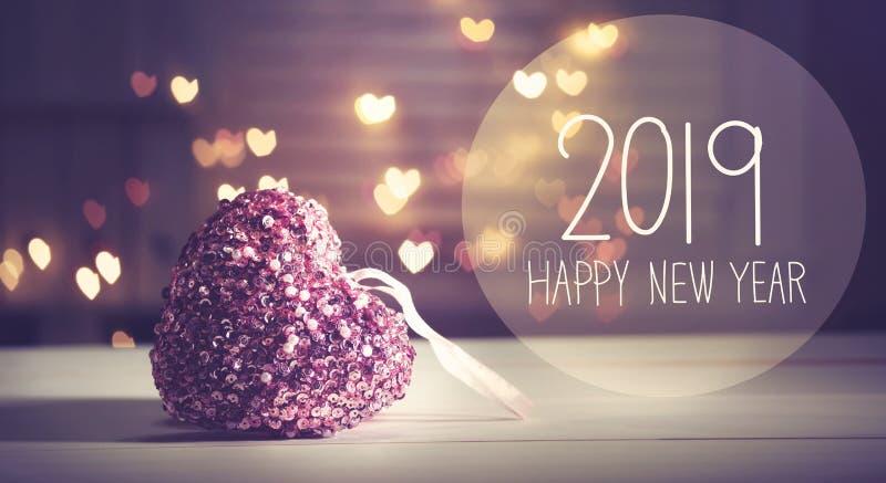 Message 2019 de nouvelle année avec un coeur rose images libres de droits