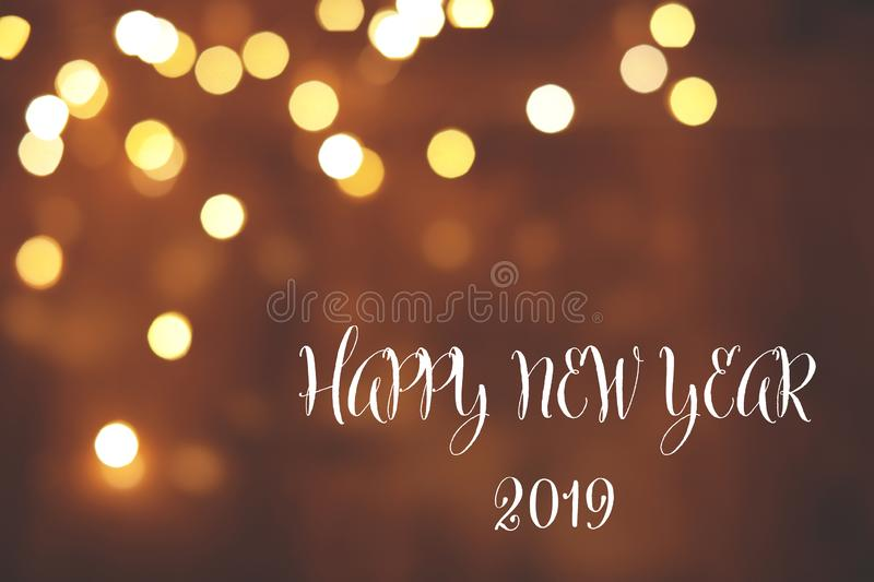 Message HAPPY NEW YEAR 2019 and bokeh effect on background, space for text. Winter holidays stock photos