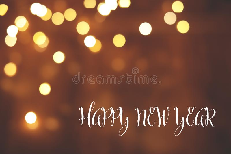 Message HAPPY NEW YEAR and bokeh effect on background, space for text. stock image