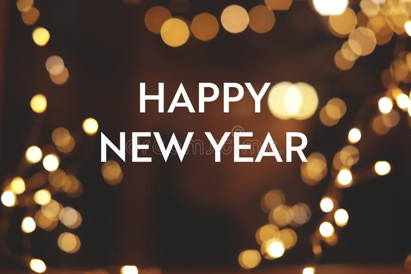 Message HAPPY NEW YEAR and bokeh effect on background. stock image