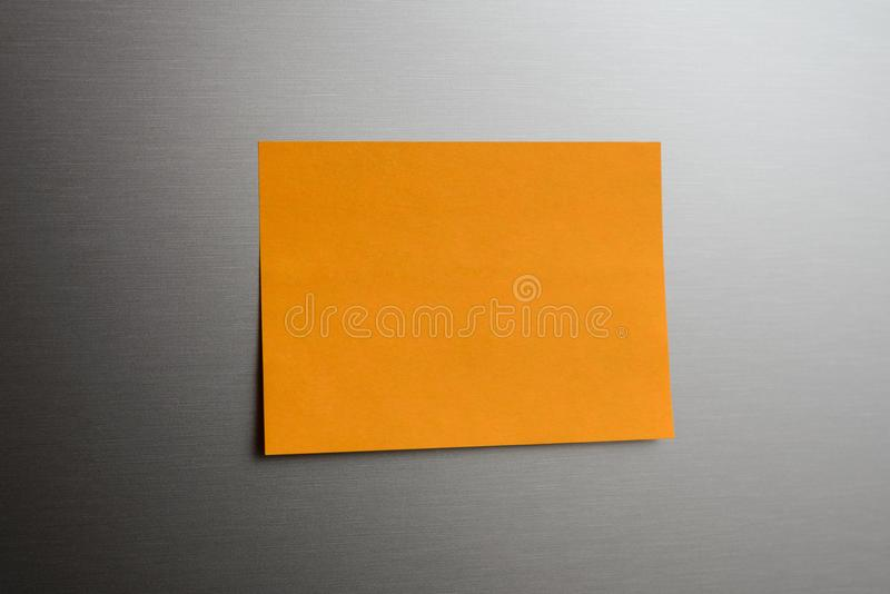 Message paper pasted on metal surface. stock image