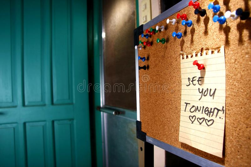 Message or reminder board with see you tonight note stock photography