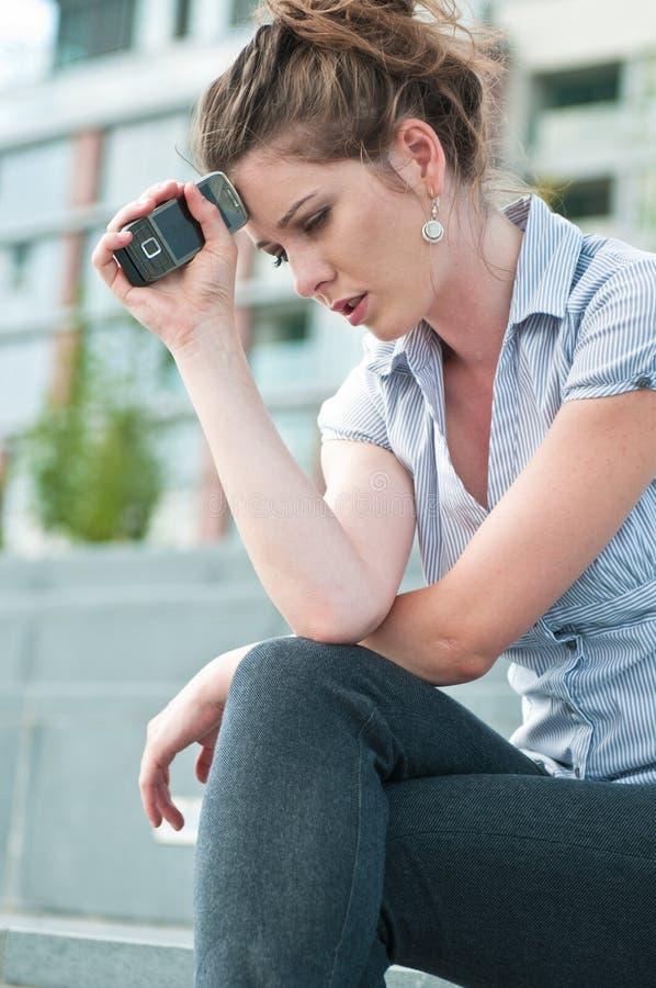 Messaggio difettoso - donna infelice fotografia stock