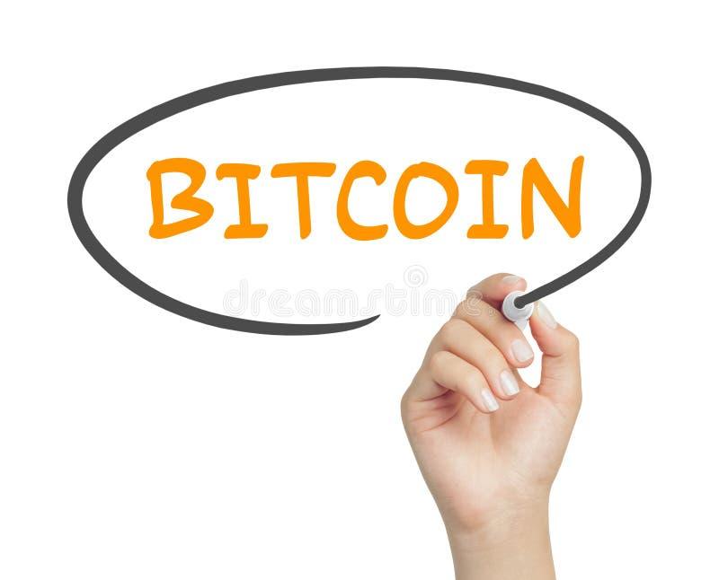 Messaggio femminile del bitcoin di scrittura della mano in pallone del fumetto con l'indicatore fotografia stock libera da diritti