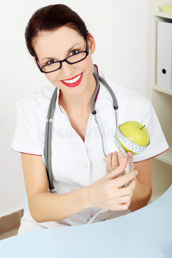 Messender Apfel des weiblichen Doktors. lizenzfreies stockbild