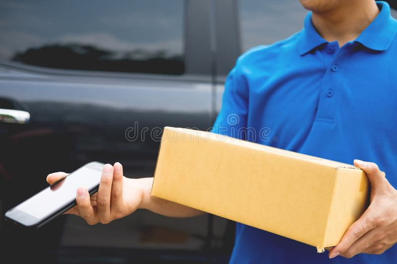 Messenger man hold box and talk on smart phone and payment termi royalty free stock image