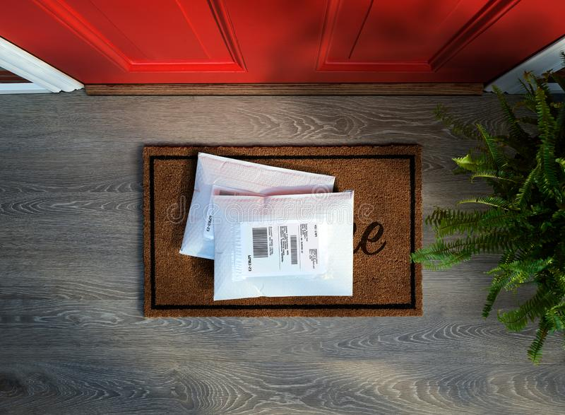 Messengered envelope packages delivered to door step. Overhead view royalty free stock image