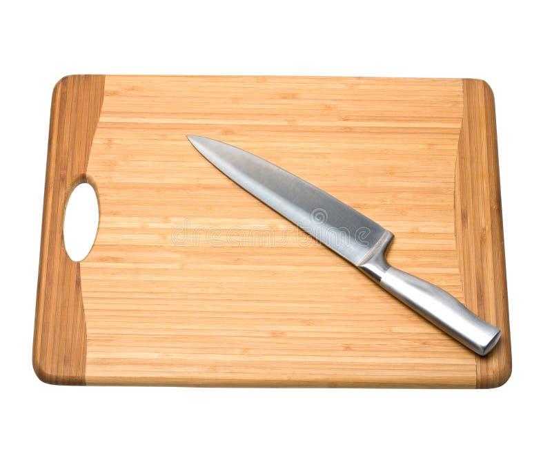Messer auf Schneidebrett stockbilder