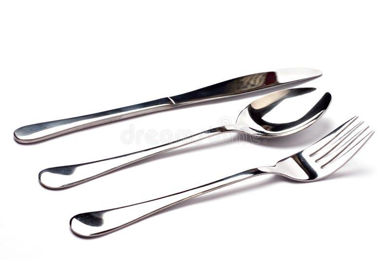 Messer, ein Löffel und eine Gabel auf weißem Hintergrund lizenzfreies stockbild
