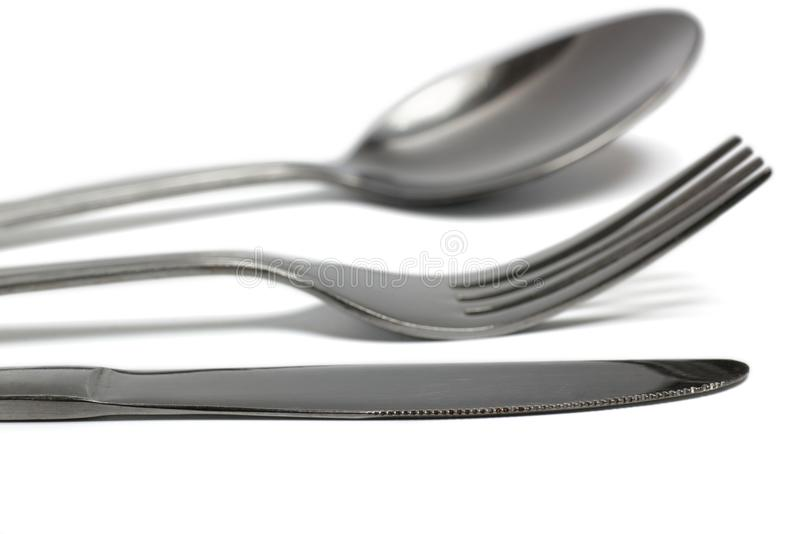 Messer, Gabel und Löffel closup auf Weiß lizenzfreie stockfotos