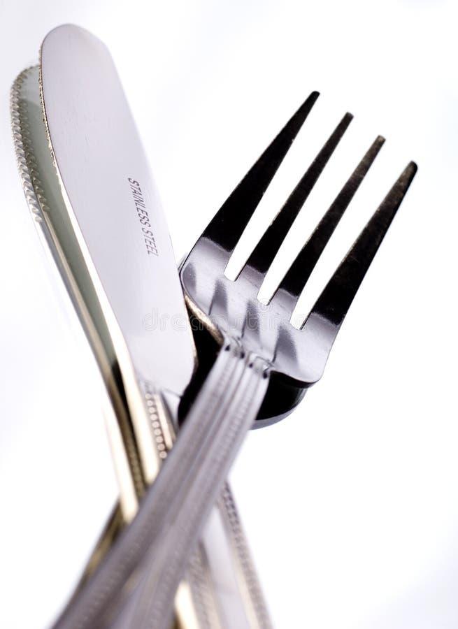 Messer und Gabel auf Weiß stockfoto