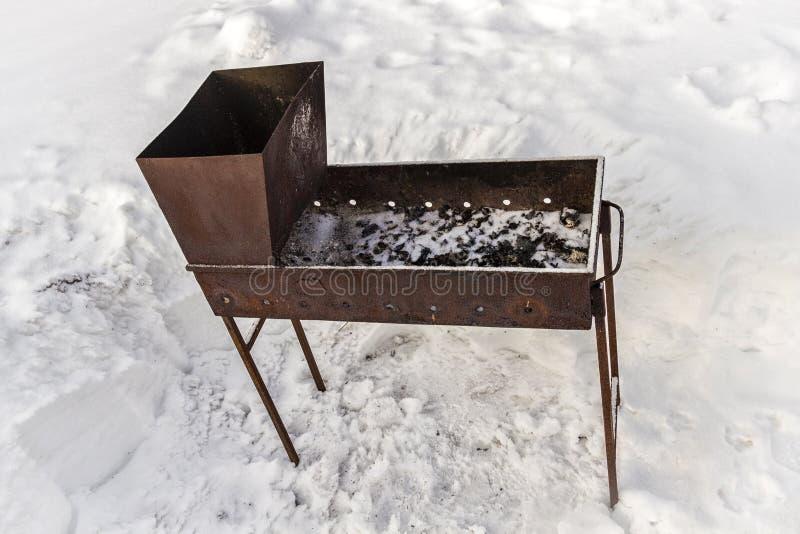 Messingarbeiter im Schnee lizenzfreies stockbild
