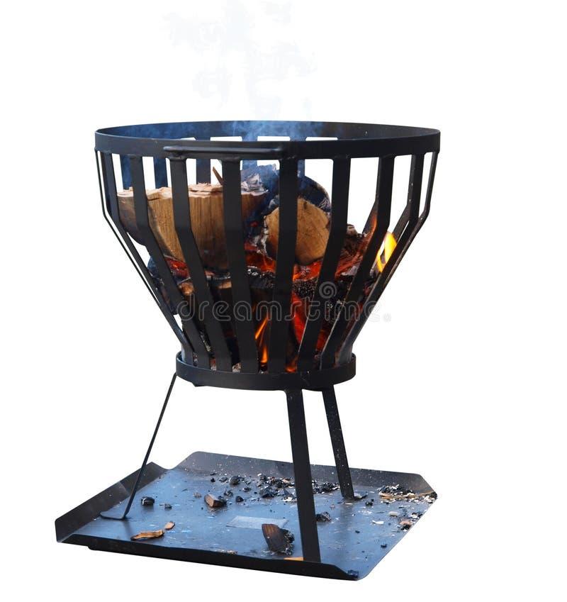 Messingarbeiter mit hölzernem Feuer lizenzfreie stockbilder
