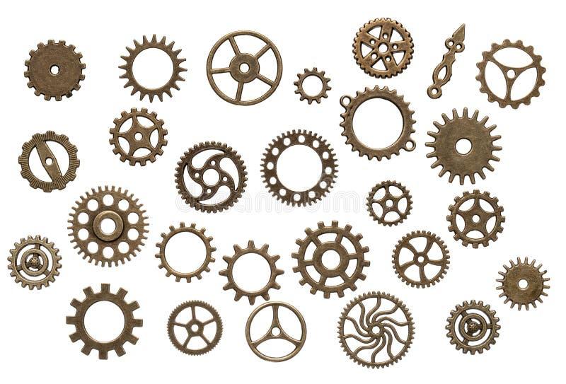 Messingzahnräder lokalisiert auf weißem Hintergrund lizenzfreies stockbild