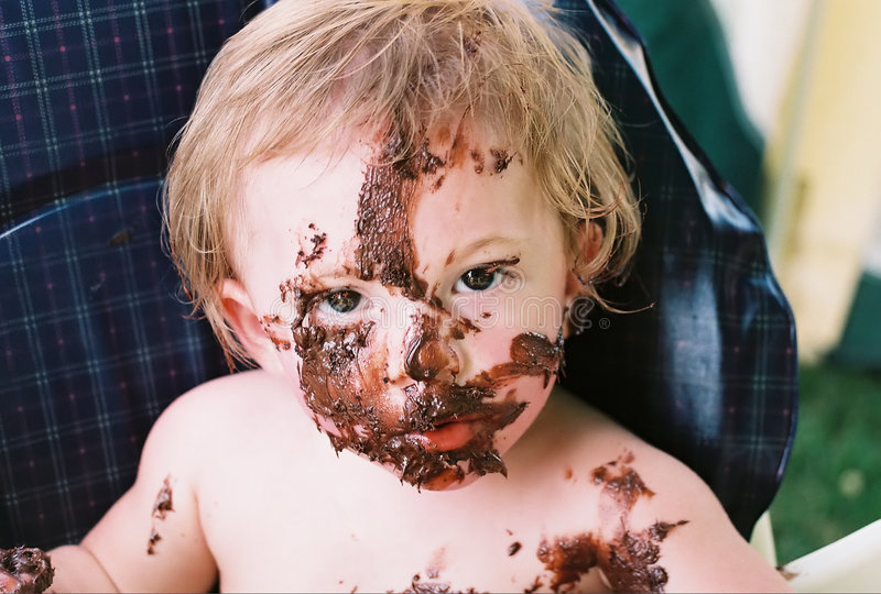 Messy Baby First Birthday Celebration. Baby after having first birthday cake . great details stock photo