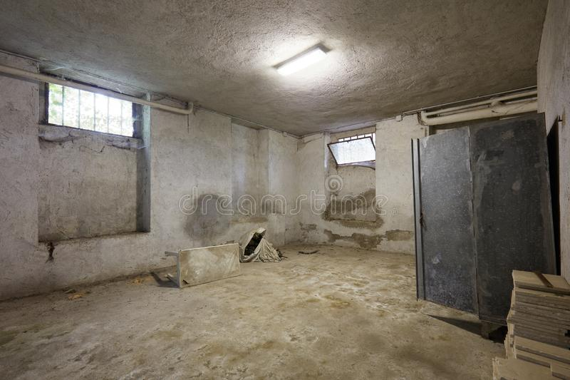 Messy basement in old house interior. With cement walls in Italy royalty free stock photo